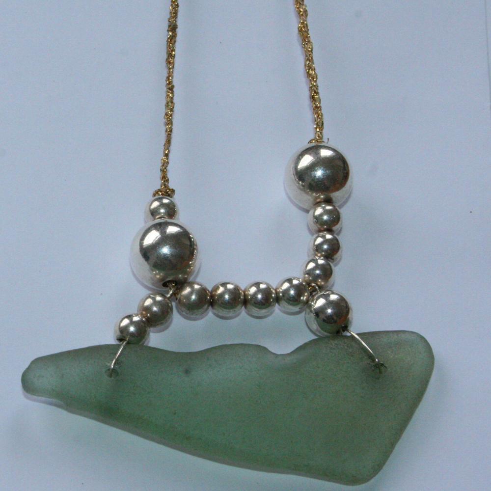 http://www.beachshackproject.bigcartel.com/product/long-deep-aqua-blue-sea-glass-necklace