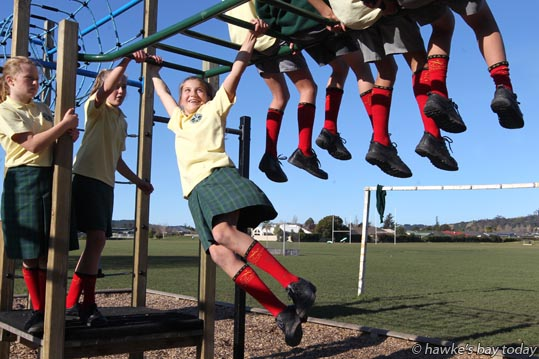 L-R: Annabelle Williams, Ella Roberts, Millie Simmons, students at Havelock North Intermediate, Havelock North, Red Socks Day, one of 13 New Zealand schools promoting the Sir Peter Blake Trust. photograph