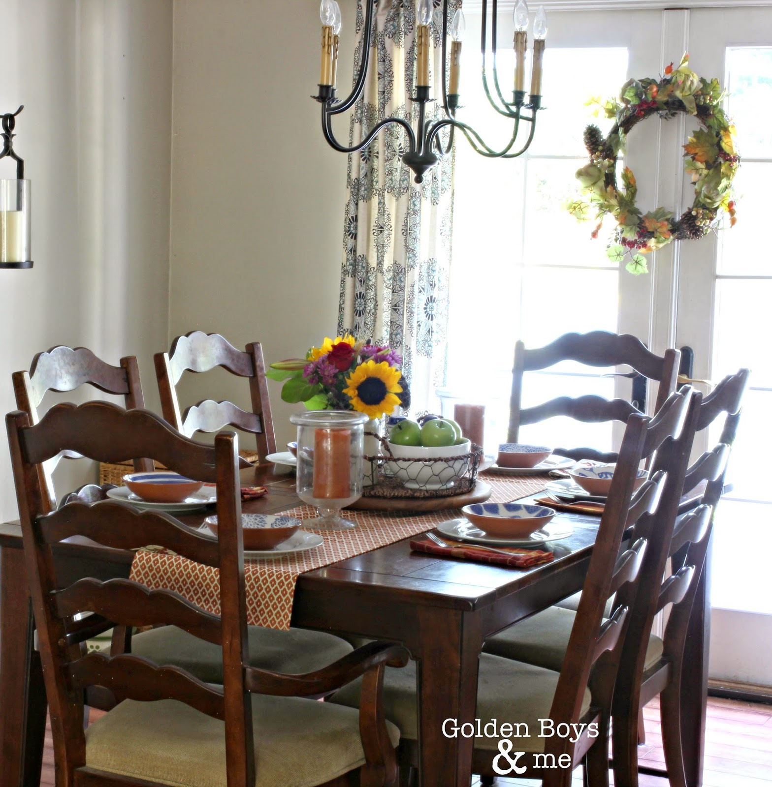 World Imports chandelier in dining room with fall decor-www.goldenboysandme.com