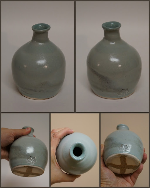 Ceramic pottery narrow necked vase / vessel with marbled design.