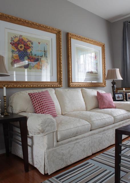 sofa with skirt and damask light color fabric