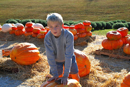 Kelby picking out his Pumpkin