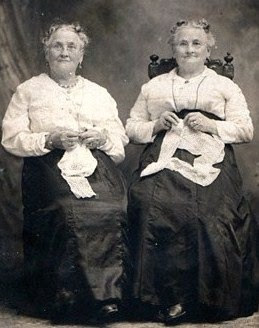 19th century twin sisters doing handwork