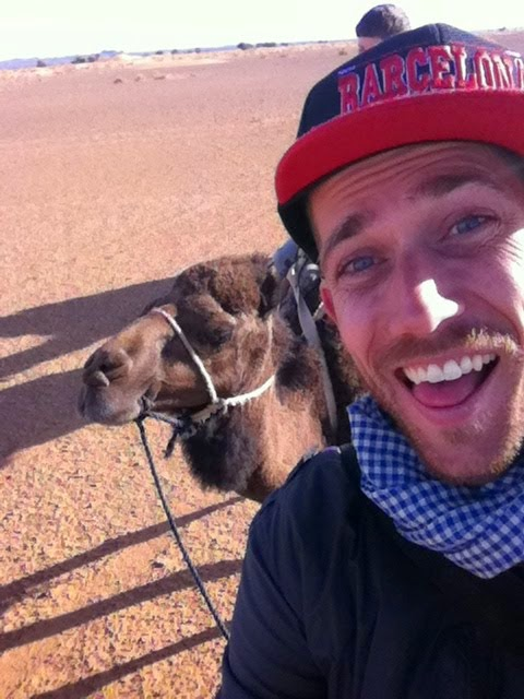 Riding a camel in the Sahara