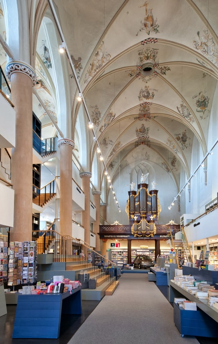 Interior of modern bookstore in old cathedral, the Netherlands