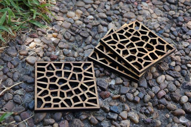 voronoi pattern bamboo coasters on rocks