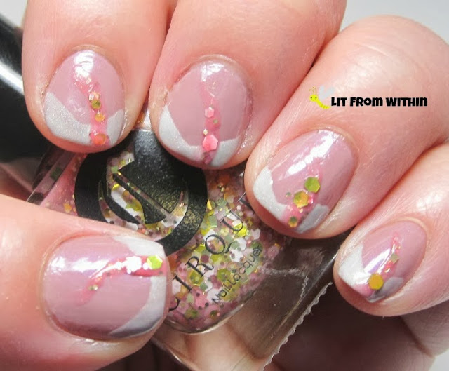This is Cirque Fleur Est Belle.  Love the pink base and gold glitters.
