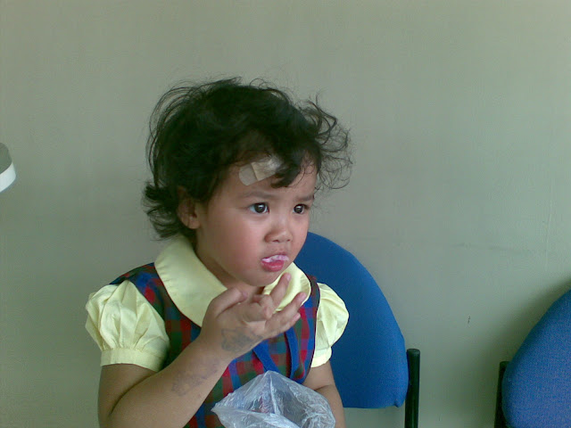 Kecil eating her cotton candy