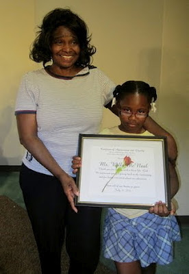 Presenting Willa McNeal with a certificate
