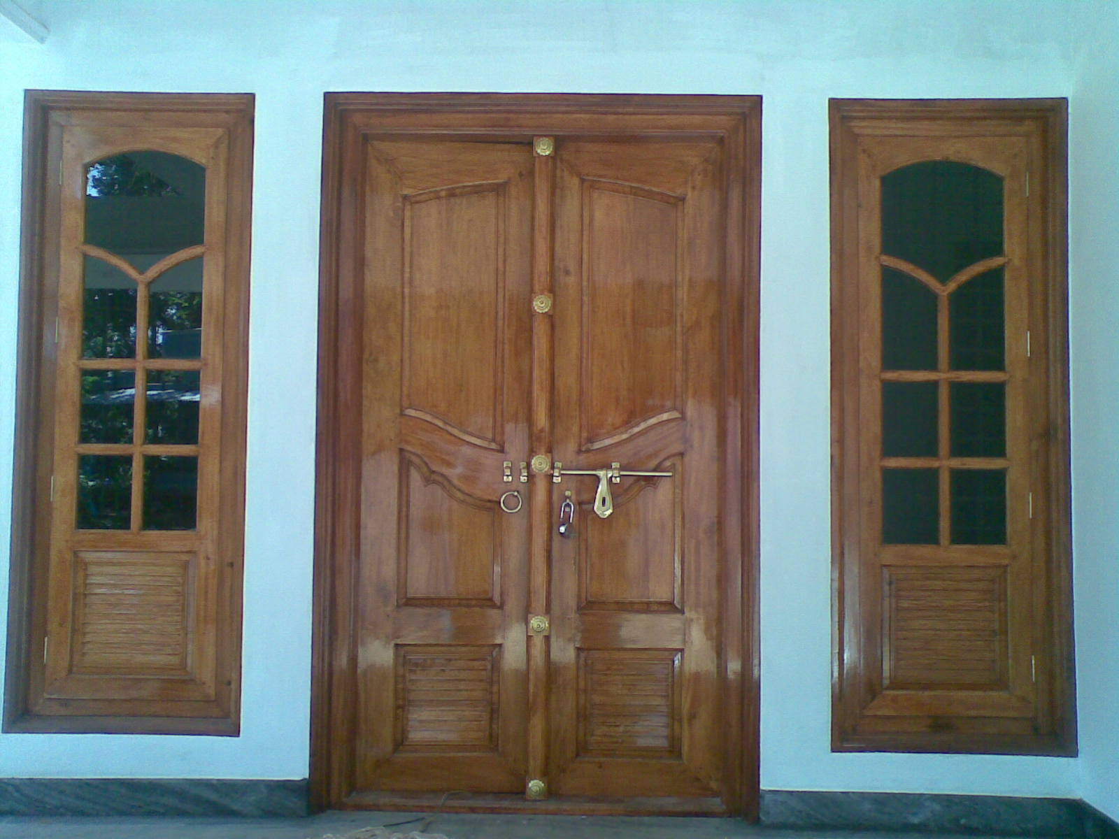 Bavas wood works kerala style wooden front door double for Indian main double door designs