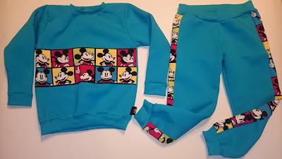 W zimowe chłodne dni proponuję Wam dres z grubej dresówki w kolorze turkusu. Całość bluza i spodenki są z drapanej (z meszkiem od spodu) dresówki a jako dodatek użyłam materiał z Myszką Miki w kosteczce.