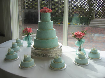 4-tier round buttercream with 2-tier fondant satellite cakes