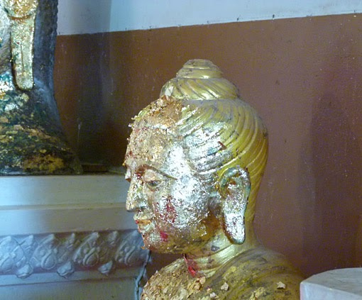 Buddha Head and gold leaves
