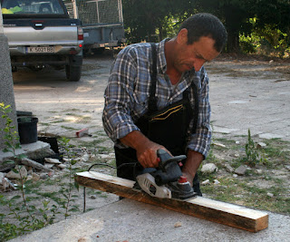 Bekir planing the wood smooth