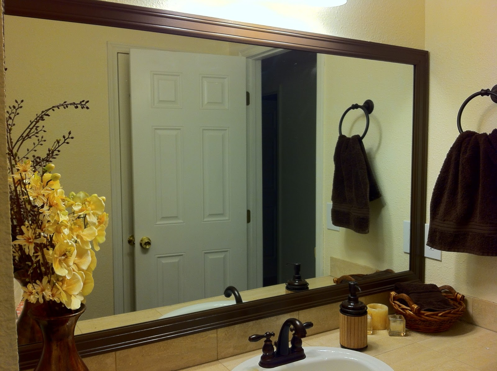 diy bathroom mirror frame for less than 20