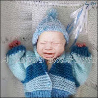 Recém-nascido com cólica, normal nos primeiros três meses de vida.