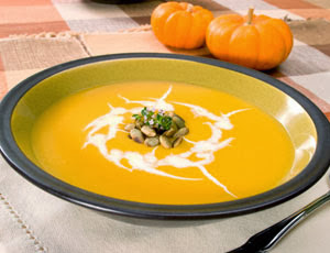 Cream of Pumpkin Soup Topped with Curried Pecans