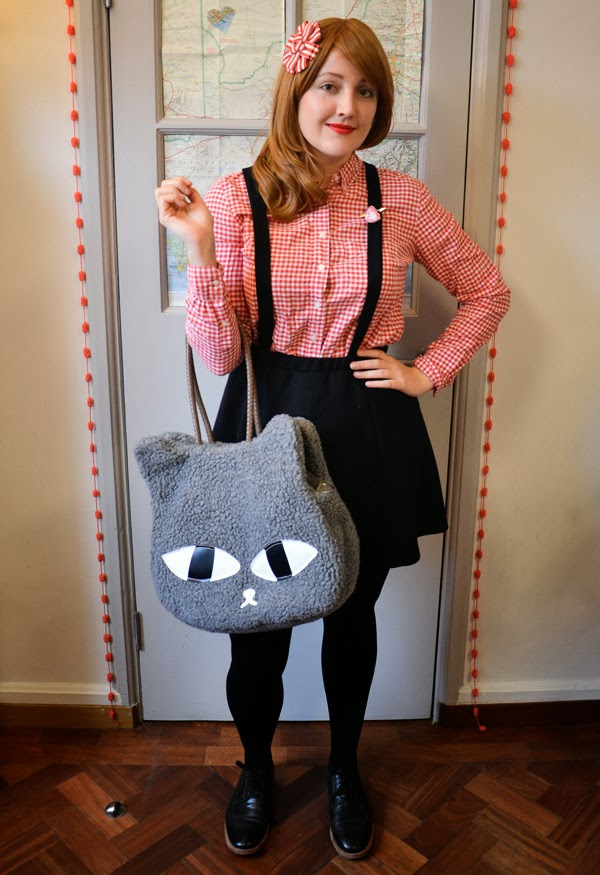 Valentine's Day outfit: red gingham shirt, red lipstick, suspender skirt and brogues with a fuzzy cat bag