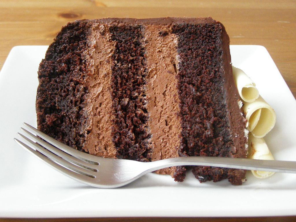 Chocolate cake, layered with chocolate mousse, topped with chocolate ...