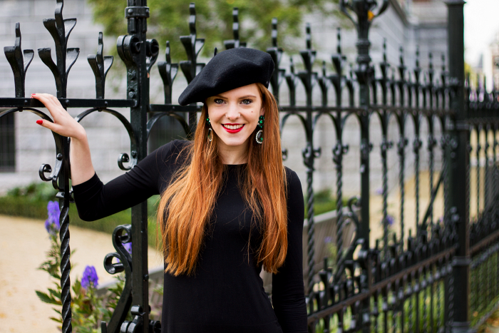 Red hair, emerald earrings, beret and black dress outfit