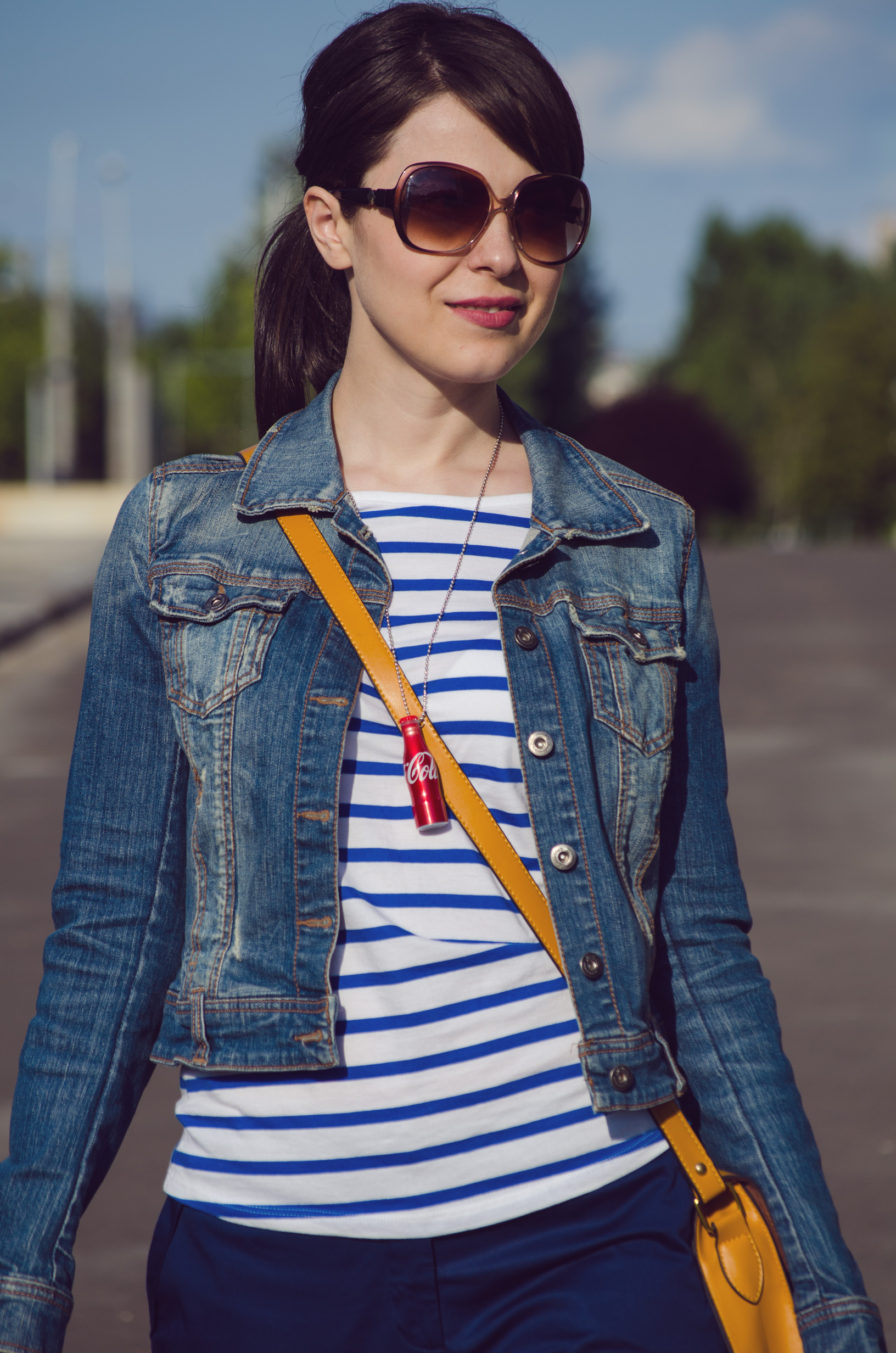 navy pants blue stripes t-shirt mustard bag flats jeans jacket coke little bottle