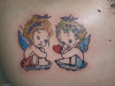 Cute Angel Tattoos,tattoo designs,angel tattoos,tattoos pics,tattoos designs,angel pictures,tattoos gallery,tattoos images,tattoos ideas,angel tattoo designs