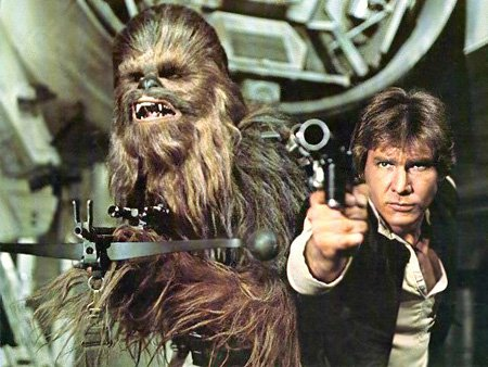 Harrison Ford as Han Solo and Chewbacca firing weapons Star Wars movieloversreviews.blogspot.com