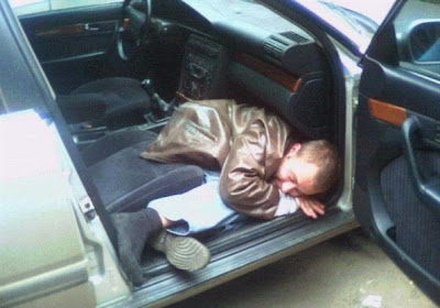 Guy sleeping in car