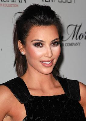 Fashionista Kim Kardashian glamorous style highlighter cheeks makeup contouring.