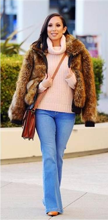 Cheryl Burke was photographed wearing a Du Monde Faux Fur jacket, Parker Smith jeans and a Patricia Nash bag yesterday!