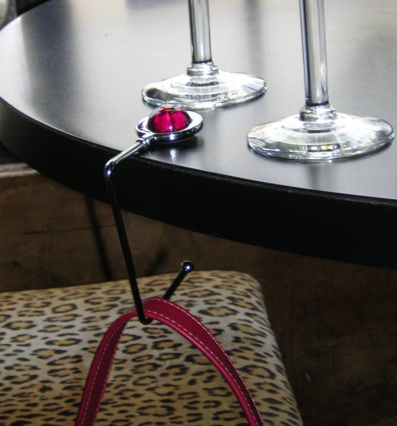 Purse hanger for poker table