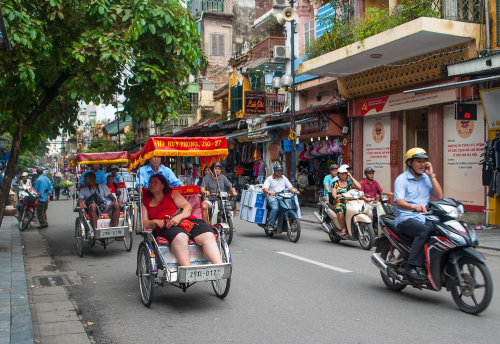 motorcycles and trishaws in hanoi