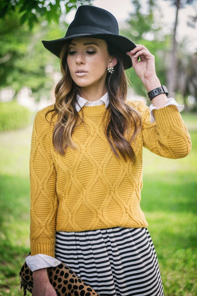 a line skirt, black and white stripe skirt, stripe skirt, black suede booties, cable knit sweater, old navy cable knit sweater, clare v clutch, leopard clutch, clare v, clare v leopard foldover clutch, madewell black fedora, black fedora
