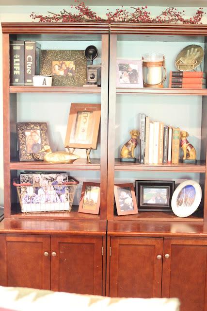 Styled Bookshelves with scrapbook paper backing via www.goldenboysandme.com