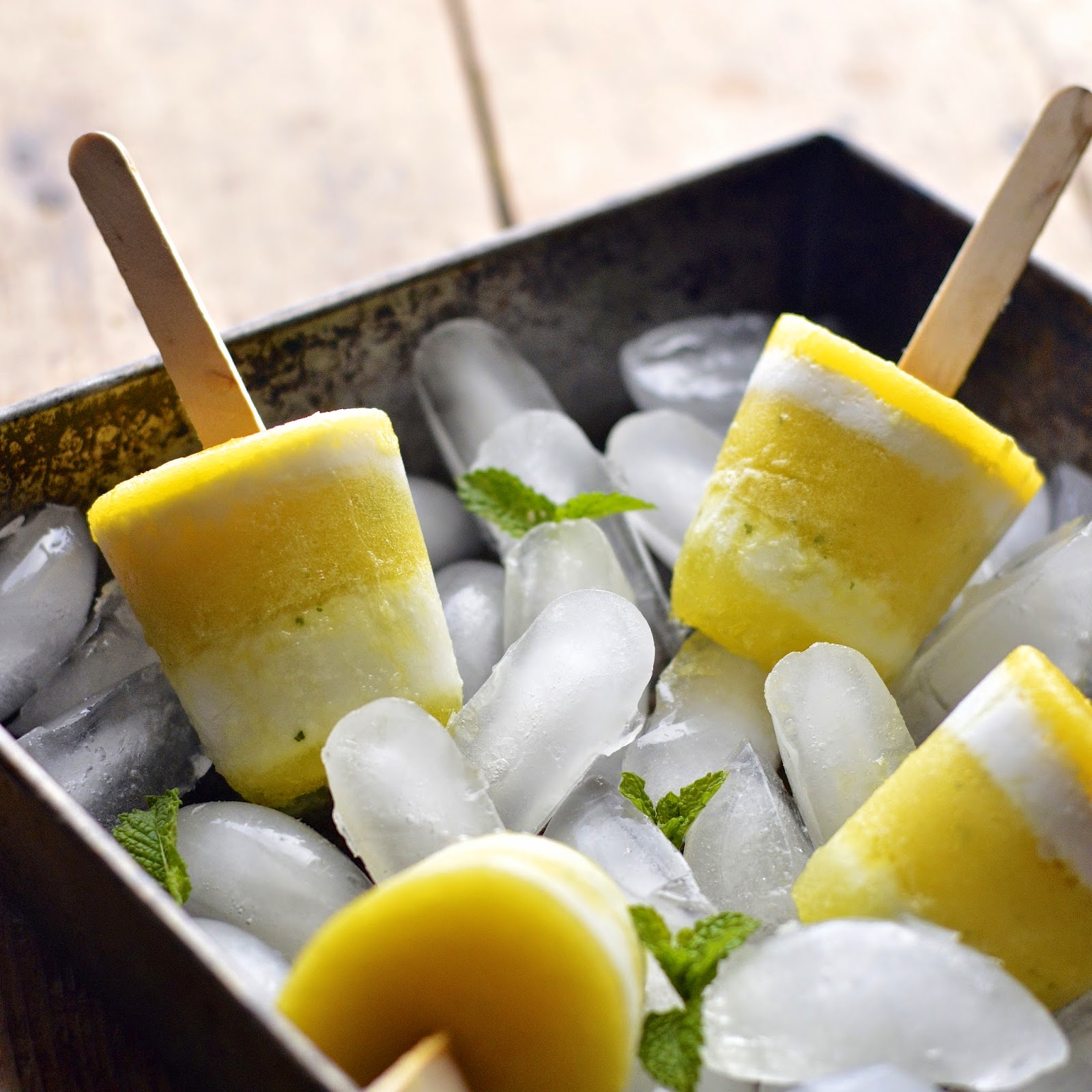 5 ingredient refreshing pina colada popsicles with a touch of mint.