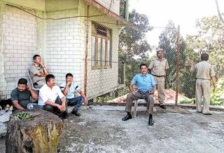 Security personnel outside Harka Bahadur's house in Kalimpong