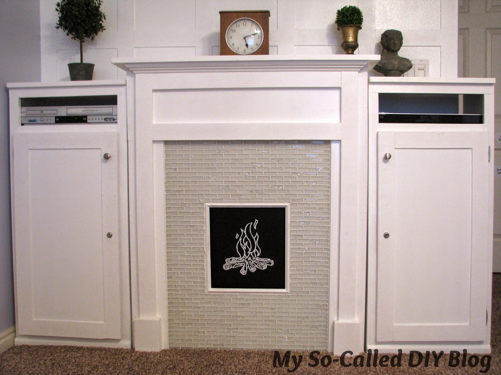 http://www.mysocalleddiyblog.com/2014/12/project-bonus-room-faux-fireplace-and.html