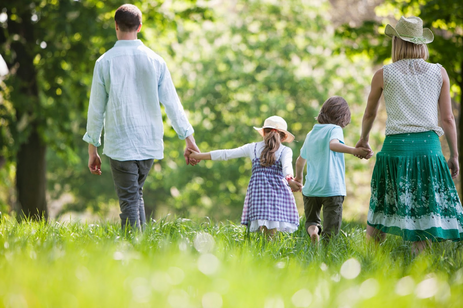 family walking hand in hand on onequartermama.ca