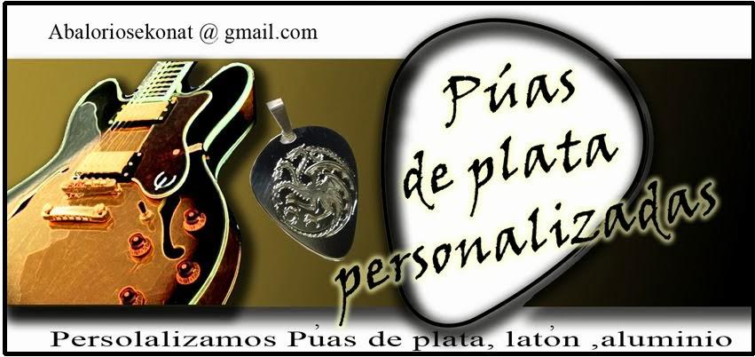 púas de plata y guitarras personalizadas