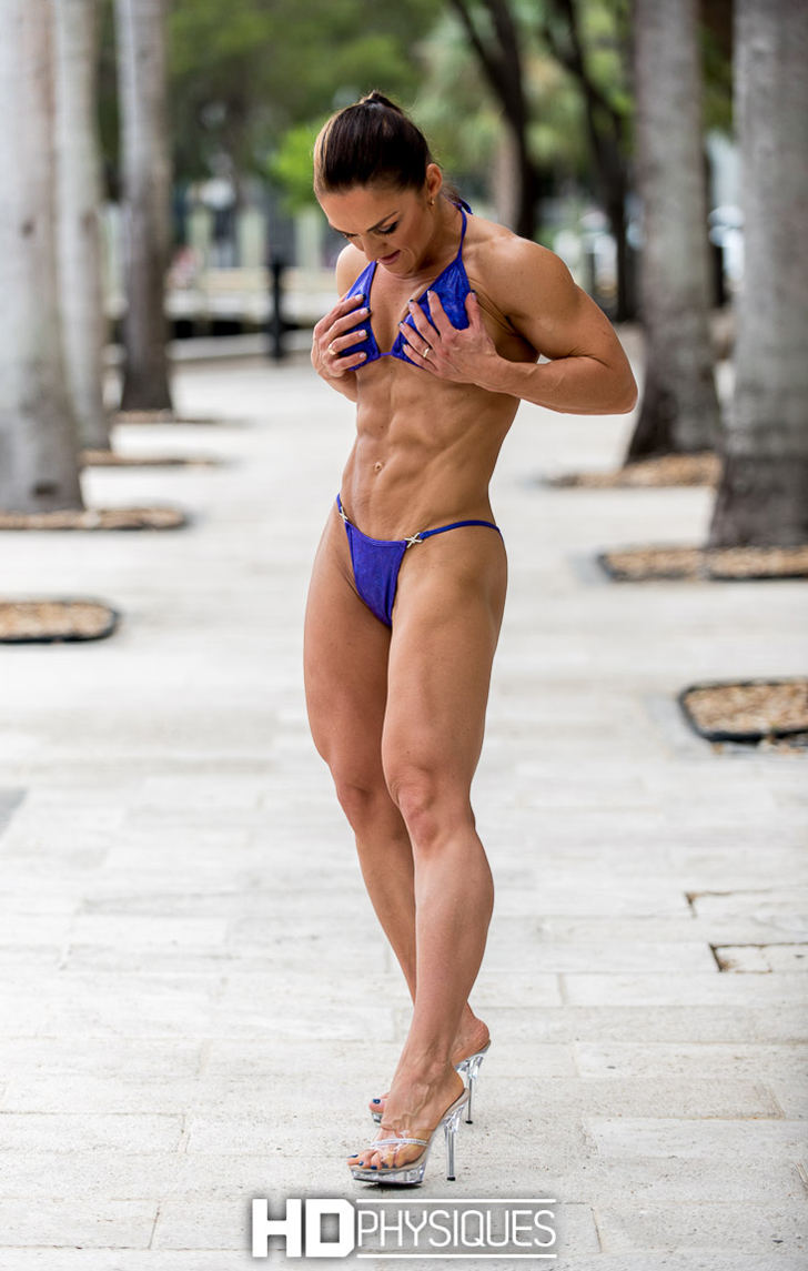 Irina Kiselev Flexing Her Shredded Abs And Muscular Legs In A Blue Bikini