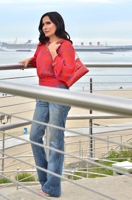 red blouse with balloon sleeves kate spade red bow patent leather purse banana republic gold and crystal bead jewelry Frankie B. low rise flare jeans Saks Fifth Avenue tan sandals with gold studs