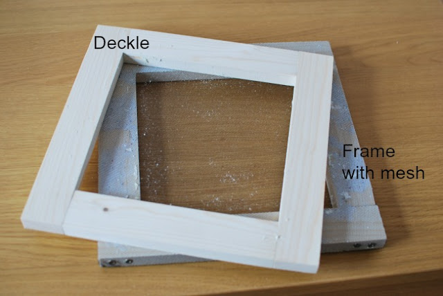 2 wooden frames. one empty, deckle. one with mesh.