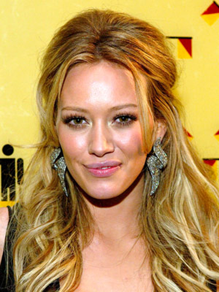 Tousled texture, pinned up sides and volume on top amps up Hilary Duff 's lengthy hairstyle