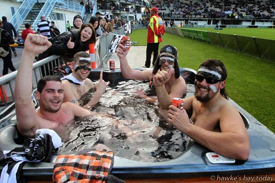 L-R: Jesse Jardine, Luke Wheatley, Mitchell Allen, Sam Strachan, all from Napier, drinking Tui beer in a spa before the game photograph