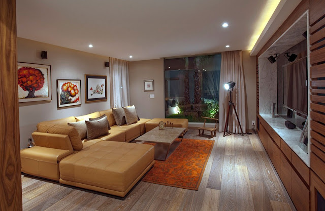 Picture of the modern home theater room with yellow sofa