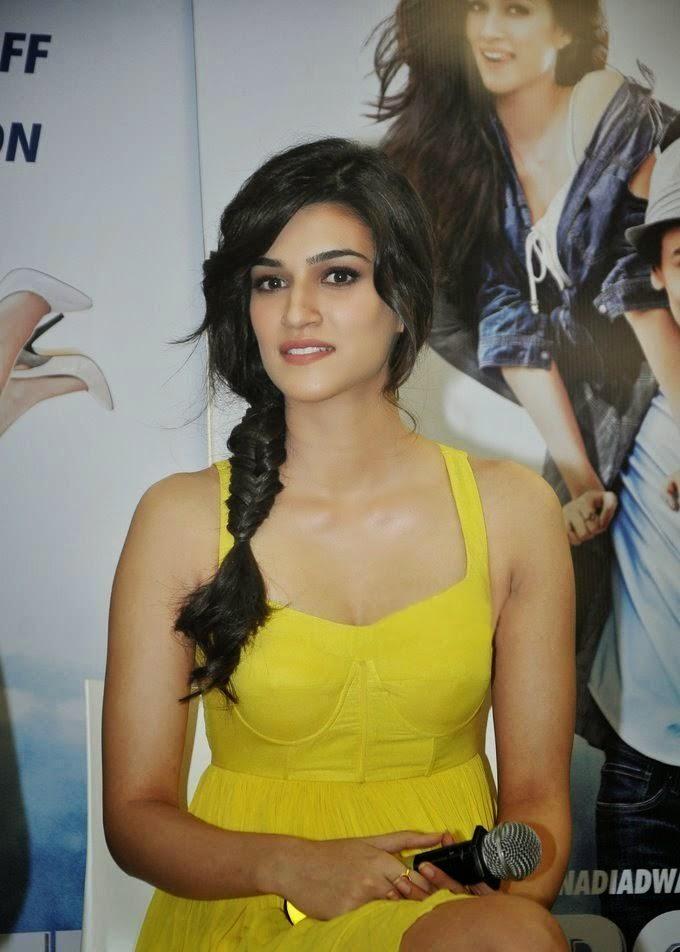 Kriti Sanon Hot exposing her big round big huge cleavage in her yello mini skirt