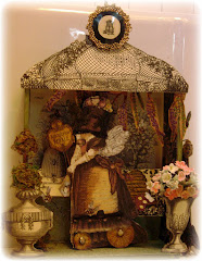 "A shadow box made from a ""Rhonda's Original"" paper doll"