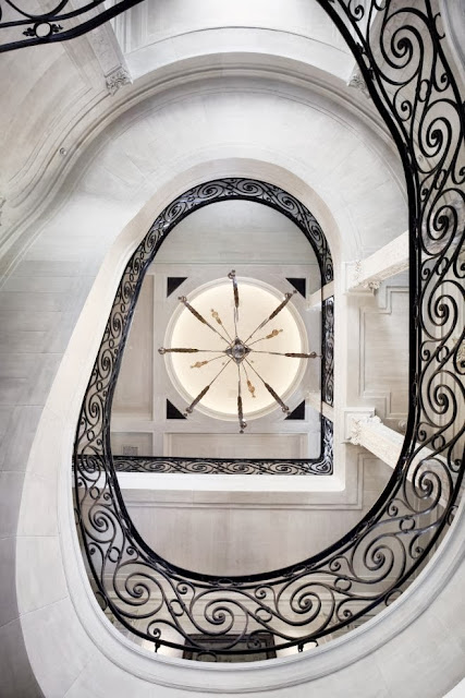 spiral staircase stairwell stairs ironwork iron railing estate mansion