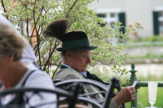 Local in the Salzkammergut area in his tracht. Note the bristle on the back of the hat is from a local mountain antelope's goatee
