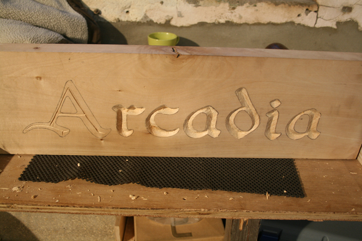 after the letters are cut the wood is sanded down to make it smooth